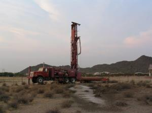 A drill rig finds groundwater in the desert.